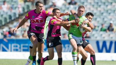 Heatwave: Raiders player Jack Wighton is tackled by Penrith.