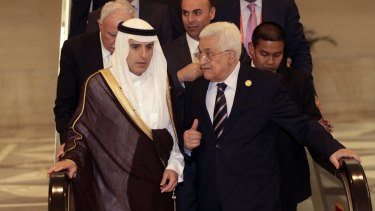 Palestinian President Mahmoud Abbas, right, talks to Saudi Arabia's Foreign Minister Adel al-Jubeir at the extraordinary Organisation of Islamic Cooperation (OIC) summit on Monday.