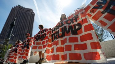 Activists protested at the Republican convention in Cleveland over Donald Trump's plans for a wall along the US-Mexican border.