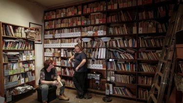 Chris (left) and Fraser Karhunkynsi in the library of the Melbourne Anarchist Club. They claim neighbouring development is causing damage to the building.