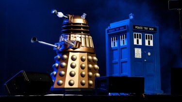 A Dalek and Dr Who's TARDIS time machine share centre stage in the Dr Who Symphonic Spectacular.