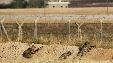 Turkish soldiers in position near the Syrian border in the Turkish border town of Akcakale on Monday.