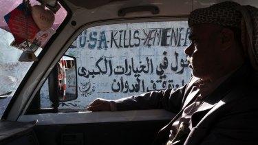 Anti-American graffiti on the street in Yemen's capital Sanaa.