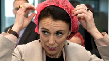 NZ Labour Party leader Jacinda Ardern puts on a hair net at a mushroom factory while campaigning in Christchurch on Thursday.