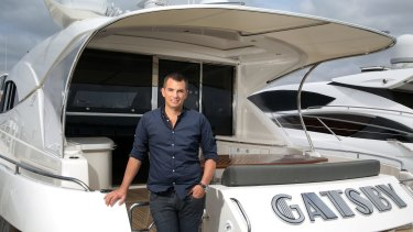 Young entrepreneur Rory Vassallo in his motor boat 'Gatsby', on the Swan River