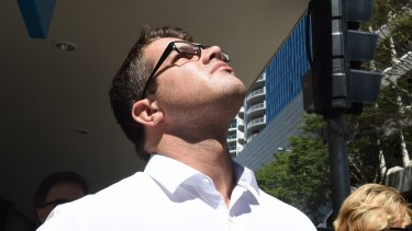Gable Tostee looks to the sky during his trial for murder at the Brisbane Supreme Court.