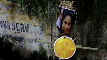 An effigy of Myanmar's State Counsellor Aung San Suu Kyi is placed against a wall before it was burnt by activists of an ultra-leftist organisation in Kolkata, India.