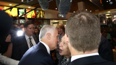 Prime Minister Malcolm Turnbull greets an enthusiastic voter.
