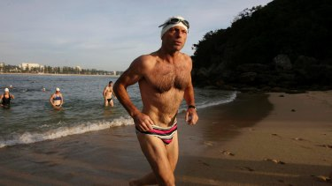 Mr Abbott competing in a charity swim in 2010, after which his budgie smugglers were auctioned on eBay.