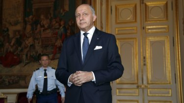 Not amused: French Foreign Affairs Minister Laurent Fabius briefs the media.