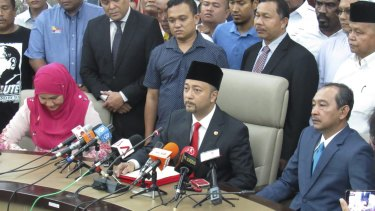 Mukhriz Mahathir, centre, the son of former Malaysian prime minister Mahathir Mohamad, at  a press conference in Kedah, Malaysia, on Wednesday. Mr Mukhriz claims he was ousted from his chief ministership of Kedah state because he criticised Najib Razak.
