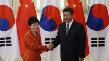 'Closely aligned': South Korean President Park Geun-hye and Chinese President Xi Jinping meet on the sidelines of the APEC summit on Monday.
