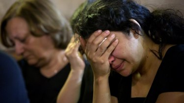 Coptic Christians grieve during prayers  remembering the victims of EgyptAir flight 804 at Al-Boutrossiya Church in Cairo.