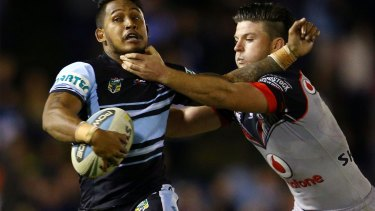Get back here: Ben Barba is collared by Chad Townsend.