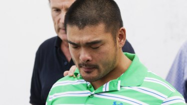 Andrew Chan's brother, Michael, holds back tears.