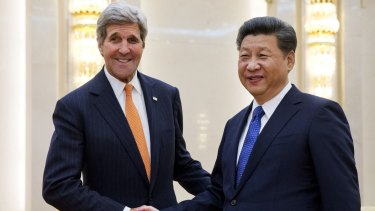 US Secretary of State John Kerry, left, poses with Chinese President Xi Jinping prior to their meeting at the Great Hall of the People in Beijing on January 27.