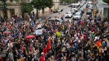 Anti-Trump protesters march along Congress Avenue in Austin, Texas, on Wednesday.