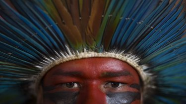 An indigenous man listens to speeches during a rally of Social Movements for Democracy, in a camp set up by supporters of President Dilma Rousseff in Brasilia on April 16.