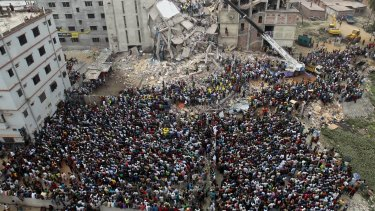 Bangladeshis gather to watch the rescue effort at the collapsed Rana Plaza building in Savar, near the capital Dhaka, in April 2013.