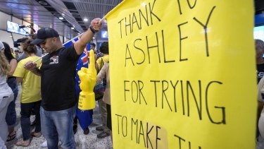 Supporters of anti-Islamic State fighter Ashley Dyball await his return at Melbourne Airport.