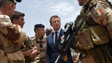 French President Emmanuel Macron talks to French soldiers in Gao, northern Mali in May.