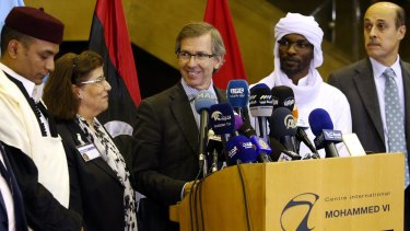 United Nations envoy for Libya Bernardino Leon, centre, announces the deal in Skhirat, Morocco, on Thursday.