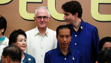 "Australian Prime Minister Malcolm Turnbull and Canadian Prime Minister Justin Trudeau during the APEC Summit ""family photo"" in Da Nang, Vietnam, on Friday."