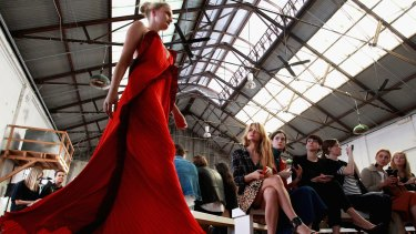 The many faces of Carriageworks - a model walks the runway at Mercedes-Benz Fashion Week Australia 2015.