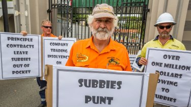 Subcontractor Barry Mitchell protests at the Eagle Farm redevelopment where two men were crushed to death, claiming he hasn't been paid for months.