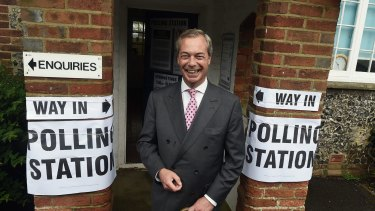 Nigel Farage prepares to vote in the referendum.