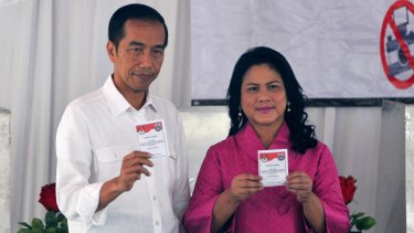 Indonesian President Joko Widodo and his wife Iriana cast their ballots. Ahok first became Jakarta's deputy governor on a ticket headed by Mr Joko.