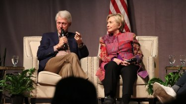 Accompanied by his wife, Hillary Clinton, former President Bill Clinton marks 25 years since his election, last month.