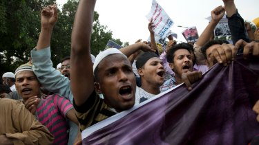 Indian Muslims shout slogans during a protest against the persecution of Rohingya Muslims in Myanmar, in New Delhi.