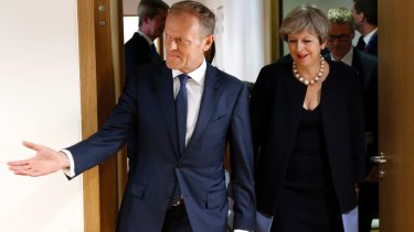 Donald Tusk, left, leads British Prime Minister Theresa May  to a bilateral meeting on the sidelines of an EU summit in Brussels.