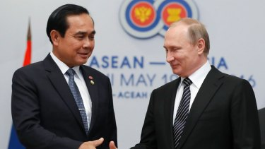 Russian President Vladimir Putin, right, shakes hands with Thai Prime Minister Prayut Chan-ocha on the sidelines of the ASEAN Summit in Russia in May.