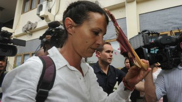 Sara Connor leaves Denpasar District Court on Monday after being sentenced to four years' jail.