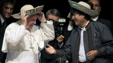 Pope Francis and Bolivia's President Evo Morales model traditional Bolivian hats at the second World Meeting of Popular Movements in Santa Cruz, Bolivia, where the Pope gave an empassioned address to delegates.