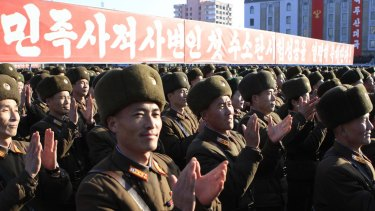 North Korean military personnel clap hands in a rally, after North Korea said Wednesday it had conducted a hydrogen bomb test last week.