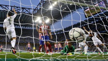 First blood: Real Madrid's Sergio Ramos, second right, scores the opening goal.