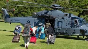 Tourists are evacuated by helicopter from Kaikoura, NZ, following the November 14 earthquake.