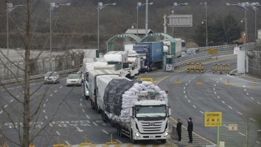 Suspending joint operation: South Korean vehicles returning from North Korea's joint Kaesong Industrial Complex pass the customs office near the border village of Panmunjom.