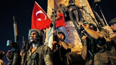 Turkish soldiers secure Istanbul's Taksim square as supporters of Turkey's President Recep Tayyip Erdogan protest in July after a failed coup.