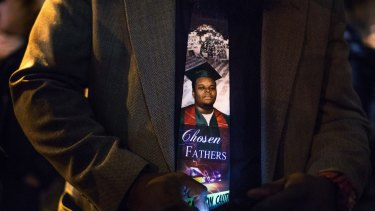An image of Michael Brown, who was killed by the police in Ferguson, Missouri, on the tie of his father, Michael Brown senior.