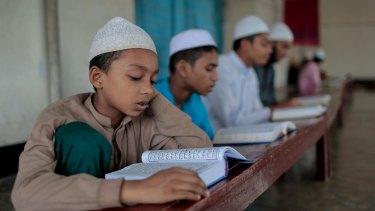 Bangladeshi Muslim students read the holy Koran at an Islamic school during Ramadan in Dhaka, Bangladesh in June 2016.