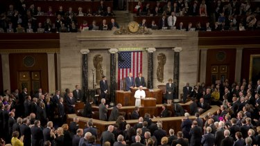 Pope Francis receives one of many standing ovations as he addresses Congress.
