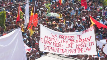At least 10,000 people protest in Dili last year against Australia's stance on the oil and gas meridian line in the Timor Sea.