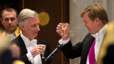Celebrations: Dutch King Willem-Alexander, right, toasts with Belgian King Philippe at the royal palace in Amsterdam on Monday.