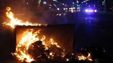 A fire burns during protests at Trump's victory in Oakland, California, late on Tuesday.
