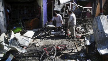 Men at the site of Monday's suicide attack in Kabul.