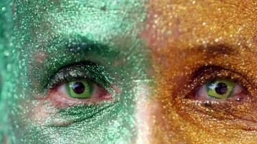 A demonstrator wears Brazilian flag contact lenses at a protest against Brazil's President Dilma Rousseff on Sunday.